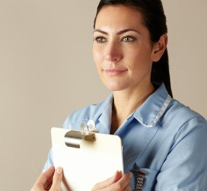 UK nurse holding clipboard